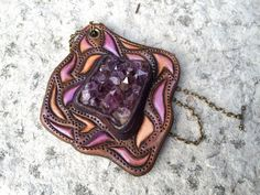 Hand tooled leather iridescent fantasy pendant by Gemsplusleather