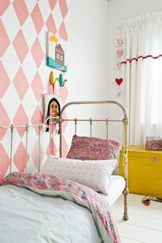 super sweet vintage inspired room with a giant patterned wall