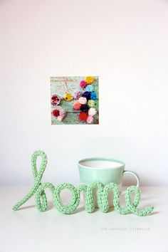 I've been eyeing this for awhile now.  Crocheted 'Home' available for purchase via idalifestyle's Etsy store.  LOVE!