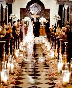 This Classic black & white tiled floor creates a romantic vintage mood with candles decorating the aisle.