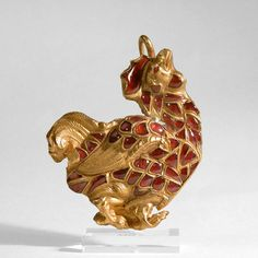 Sassanian Gold Buckle / Fibula in the Shape of a Rooster Culture : Persia Period : 5th - 7th century A.D. Material : Gold and Rubies