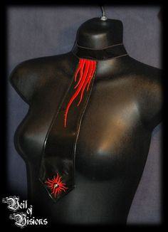 Tie choker in black PVC with tentacle embroidery and a spike stud. £25