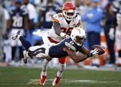 San Diego Chargers wide receiver Eddie Royal, front, can't hold on to a pass as Kansas City Chiefs defensive back Ron Parker defends during the second half in an NFL football game, Sunday, Dec. 29, 2013, in San Diego. (AP Photo/Lenny Ignelzi)