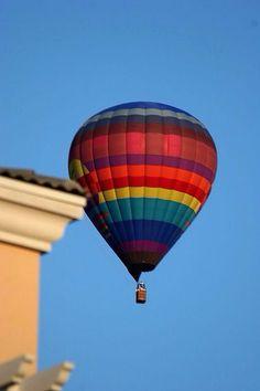Hot Air Balloon next to a house