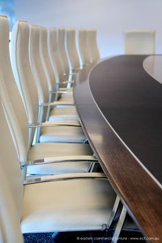 An awesome boardroom table featuring aluminium and leather inlay, paired with our Aria Executive chair in white leather.