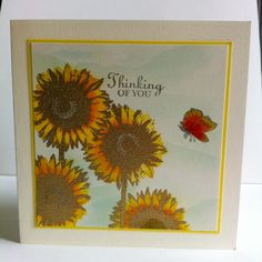 Gold Sunflower embossed card. The background is done using tumbled glass distress ink.