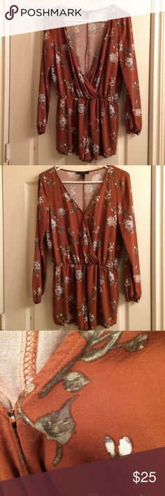 Rust orange floral long sleeve romper Rust orange floral long sleeve surplice romper, perfect for fall, size large but could fit a medium also, snap button closure on the front, NWOT #forever21 #boutique #floral #rust #orange #fall #long #sleeve #romper #surplice #gray #white #vneck #v #neck Forever 21 Other