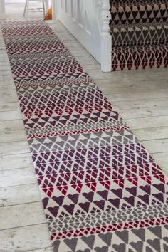 Alternative Flooring's Quirky B Margo Selby Fair Isle Reiko Carpet. The warm, rich tones of the Quirky B Margo Selby Fair Isle Reiko Carpet make it perfect for the bedroom, lounge, dining room, stairs or home office. Carpet Manufacturers, Alternative Flooring, Patterned Carpet, Red And Pink, Rugs On Carpet, Bohemian Rug, Dining Room, Stairs, Lounge