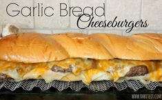 Garlic Bread Cheeseburgers is a 2 foot long, buttery, garlicy loaf of warm, tender Garlic Bread that's filled with 2 types of Cheese and thick, juicy Hamburgers! Take that Patio cook-out to the n… Incredible Recipes, Great Recipes, Favorite Recipes, Yummy Recipes, Paninis, I Love Food, Good Food, Yummy Food, Quesadillas