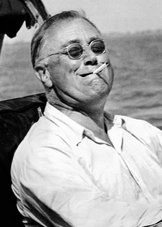 President Franklin Roosevelt smokes a cigarette while fishing for tarpon during his vacation on the Gulf of Mexico. May 10, 1937. (CSU_ALPHA_141) CSU Archives/Everett Collection