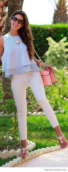Nude pants, blue top, pink bag and some sandals