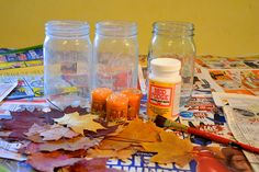 These Autumn lanterns are pretty and easy to make. And perfect for Thanksgiving!         First you need to gather some pretty colorful fall...
