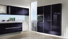 Blackberry gloss designer kitchen in a modern & uncluttered slab style.