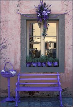 Window, Venzone, Italy.  I'm thinking about putting some purple accents on my gray house.  The doors maybe and now that I've seen this a wreath and a bench too.