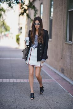 Chic in a mariner-inspired blazer with a nautical tee paired with a miniskirt and mules.