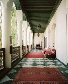 Patio Sofa Photo - Open-air walkways accented with Moroccan architecture- the olive ceiling with the tile is great