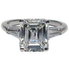 2.37 Carat Emerald Cut Diamond Platinum Ring | From a unique collection of vintage engagement rings at https://www.1stdibs.com/jewelry/rings/engagement-rings/