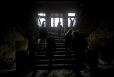 People walk inside the burnt trade union building, in Odessa, Ukraine, on May 4, 2014, where people died in in a fire that tore through the building. More than 40 people died in riots two days earlier, some from gunshot wounds, but most in a horrific fire that tore through a trade union building. (AP Photo/Vadim Ghirda)