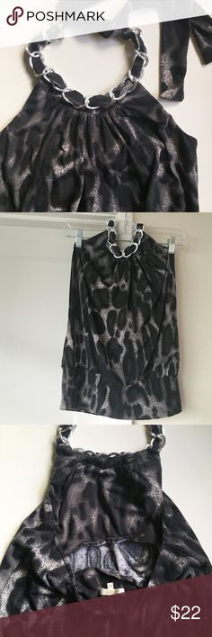 """Animal Print Halter From Saks 5th Ave outlet. Animal print, tie neck halter. Shades of black, gray, white. Silver metal chain at neck is lightweight (it sounds like metal, but is light enough that I wonder if it's plastic on inside). Wide band at hem. Lined only on top half, in front, and a small strip at top of back. Elasticized band at top of back. 95% Polyester/5% Spandex. About 20"""" long from center of neckline to hem. Hem 4.5"""" wide. Worn a few times, in great condition. maddy m Tops"""