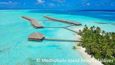 An overwater bungalow at Medhufushi Island Resort in the Maldives. More reasonably priced than those in Bora Bora, so it fits better on this bargain-hunter's Bucket List!
