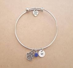 THIS is the perfect present for a dog lover! Silver Dog Paw Bangle Bracelet - Dog Paw Charm Bracelet | #ad
