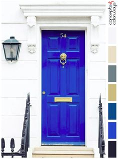 bright blue in white wall, pantone lapis blue, cobalt blue, sapphire blue, royal blue, bright blue front door, gold door hardware, wrought iron railing, black lantern wall sconce