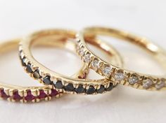 pavé bands by Lauren Wolf Jewelry in white diamonds, black diamonds and rubies.