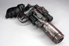 """Enforcer KMS 2017 by Peter Ong, the kit was designed by Rick L. While this pistol never appeared in the movie Bladerunner it was certainly inspired by it!"""" John S. Sci Fi Weapons, Weapon Concept Art, Fantasy Weapons, Weapons Guns, Guns And Ammo, Future Weapons, Cool Guns, Rifles, Firearms"""