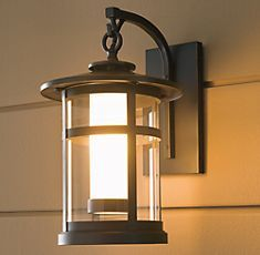 Similar to our current front porch light - love the nautical feel