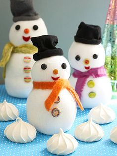 DIY small sock snowmen. Kid's craft. - I have a ton of too-small baby socks running around here now... these might be cute to make and give away! :)