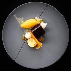That stunning parfait of passion fruit comes with mandarin and chocolate. Looks…