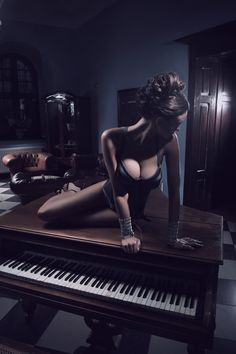 Sexy actress laying on a piano by artur k on 500px