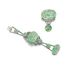 JADE AND DIAMOND BRACELET AND BROOCH. Each set with carved jadeite plaques, highlighted with circular- and single-cut diamonds, bracelet length approximately 160mm.