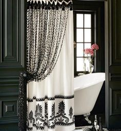 Black paint, one pretty shower curtain and one beautiful print window treatment panel with a decorative tie back created high drama around this old fashioned white clawfoot tub! So Parisian <3