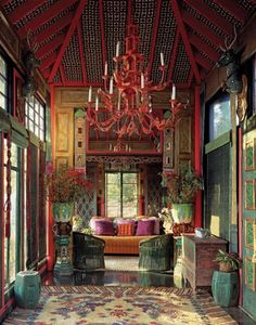 """The Tea House"" which Duquette decorated with an antique Chinese silk temple rug on the floor, Asian antiques and a pagoda chandelier of his own invention.  The ceiling was upholstered between the red lacquer beams with quilted bedspread fabrics which Duquette felt resembled inlaid tiles."