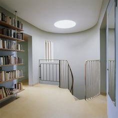 The Top Landing at 2, Willow Road, is flooded with light from above. The stair terminates beneath a circular roof-light.