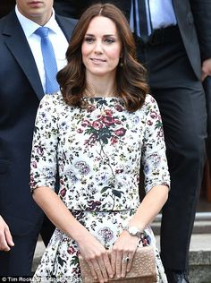 The Duchess looked summery in a floral outfit by Erdem, one of her go-to designers, and carried a simple nude clutch