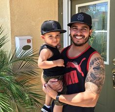 """From the @lifeofdad Instagram feed:  """"Chillin with my lil man!  He wanted a quick pic because we had matching hats on.""""  - user @SD4li"""