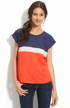 "Seaming at the rounded neck helps perfect the fit of a boxy cap-sleeve top blocked with bold, contrasting colors.  Approx. length from shoulder: 23"".  Polyester; machine wash.  note- the neckline dart."