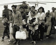 Fall of Saigon, April 1975: SV refugees, airlifted to US Navy flattop, are led to shelter. The evacuation was as chaotic as nearly a failure.