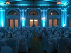 Wedding lighting at Greysolon Ballroom. Duluth, MN. Up lighting in teal. Duluth Event Lighting reception lighting, bridal lighting, wedding photography.