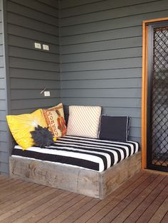 outside reading nook. May want to change the cover of the mattress but the idea is cute! Also if there's a little stand for a glass of juice that'd be even better!