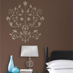 The WallPops Nouveau Damask wall art kit is a modern damask with a silver metallic ...