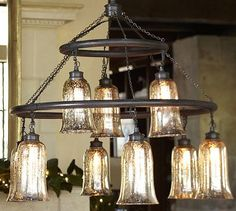 $479. This one gives you the vintage industrial look that you like, but would be traditional enough for Corinna.  Brantley Mercury Glass Chandelier #potterybarn