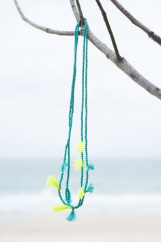 Turquoise Bay 5 Tassel Necklace. S A L T | W A T E R The cure for anything is salt water: sweat, tears or the sea. Turquoise Bay is one of Western Australia's most gorgeous beaches, and our stunning 'Turquoise Bay' accessories match the beautiful clear waters. On trend neon tassels add something special to your outfit, and all items are designed to layer and stack to add extra oomph. What makes these gorgeous necklaces special is the additional length! #RubyAndLilli