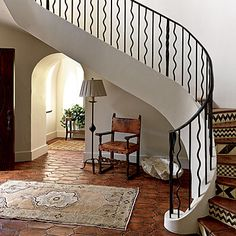 """New Look: Atlanta-based interior designer Susan Lapelle found ways to incorporate antique pieces but update them for a fresh feel. She chose stairwell tiles with bold geometric designs instead of the classic Tuscan versions. """"They would have looked too dated,"""" Susan says. Thad had all of the black ironwork in the home—including the front gates and the entry balustrade—custom-made by a craftsman Charles Calhoun in Atlanta."""