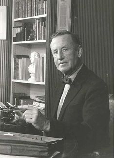Ian Lancaster Fleming (1908-1964), at home in his study. ~  Ian Fleming was an author, journalist and naval intelligence officer. Educated at Eton, Sandhurst and the universities of Munich and Geneva, Fleming moved through several jobs before he started writing. In the Naval Intelligence Division during WWII, he was involved in planning Operation Goldeneye, 30 Assault Unit and T-Force. His wartime service and career as a journalist provided the background and detail of the James Bond 007…