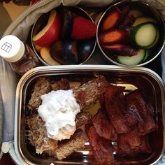 Pretty amazing lunch of leftovers today: #vegan #coconut encrusted french toast (recipe at www.tcnm.ca blog) with vegan whipcream made with coconut milk, cinnamon infused maple syrup and bacon  Snacks of fruit salad (apples, plums and raspberries) and rainbow carrots and cucumbers. Lucky girl!