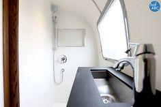 1974 Airstream Overlander restored modern bathroom, black and white