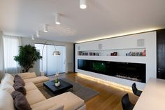 Contemporary Minimalist Apartment Living Room Interior with Integrated Modern TV Wall Unit and Bookshelf